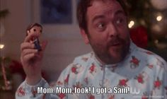 It's Crowley in a onesie. And Satan dressed as Santa. Oh my Chuck.