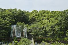 Sayama Forest Chapel by Schemata Architects - Saitama, Japan. Timber interior + cast aluminium tile roofing