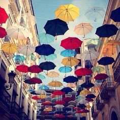 Umbrella street decor.. could be awesome at an outdoor venue for a wedding