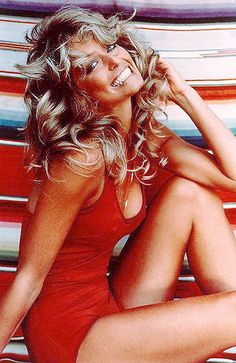 Farrah Fawcett Poster, probably the most popular poster of the 70s. Thanks to Farrah, I think nearly everyone in school purchased a curling iron to get those curls around the face.