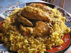 Saffron-infused Moroccan chicken is easy to make and very tasty on a bed of rice. The same base recipe is used for Bastilla and Seffa Medfouna. Morrocan Food, Moroccan Dishes, Moroccan Recipes, Moroccan Rice, Moroccan Arabic, Indian Dishes, Couscous, Saffron Chicken, Saffron Recipes