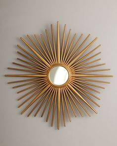 Golden Sunburst Mirror at Horchow. I just LOVE this. I'm SURE there's a way this same look can be captured by repurposing other items...