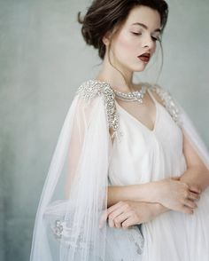 Anastasia A romantic heirloom bridal adornment, perfect for brides that wish for a truly exceptional piece on their wedding day or simply those that feel that a traditional veil isnt quite for them. Completely hand embroidered using couture techniques, the shoulder adornment is made
