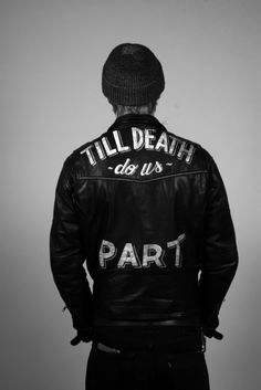 "leather jacket with ""Till death do us part"" painted on the back"