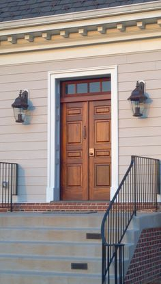 A classic colonial exterior door custom made from rich, elegant mahogany and featuring a mahogany transom above.