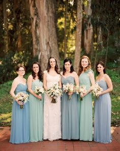 Love the soft shades of blue and green Dessy Group bridesmaid dresses