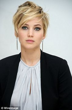 Familiar! As Jennifer Lawrence played around with her new short 'do on Friday, her look echoed one of Victoria Beckham's old favourites