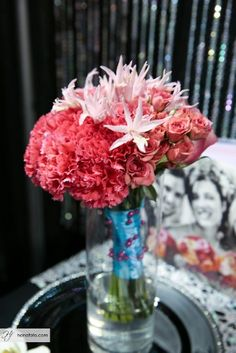 Pink carnations, nerine lilies  pink spray roses. Blog - Flowers By Janie Calgary Wedding Florist  Image: Hanafoto Photography