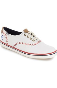 Supporting the fave baseball team with these cute Keds sneakers detailed with bright, baseball-inspired contrast stitching and an embroidered team logo.