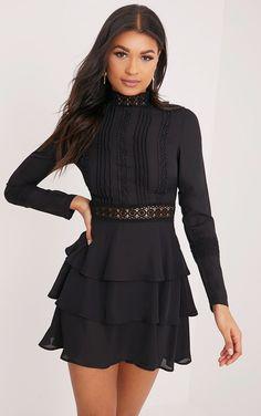 116323edc1 Black Crochet Lace High Neck Ruffle Swing DressChannel feminine vibes in  this swing dress. Featur