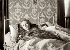 """""""Mrs. Ocey Snead, in bed, baby in arms,"""" December 1907 or January 1908. 5x7 glass negative, George Grantham Bain Collection. View full size. Ocey, who was found dead in an East Orange, New Jersey, bathtub in November 1909, drugged and emaciated, was at the center of scandalous murder case involving her mentally unbalanced mother and a spinster aunt who starved herself to death while awaiting trial. Along with a third sister they were thought to have conspired to drug and starve Ocey to colle..."""