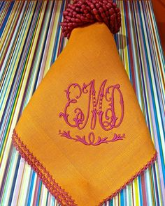 I love the bright vibrant pink and orange color combination on these monogrammed napkins.  Anything but old fashioned!