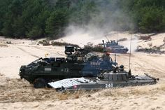A U.S. Army Stryker reconnaissance vehicle joins forces with two Slovak BMP-2 infantry fighting vehicles during a live-fire exercise Sept. 16, 2015 in training areas near Bratislava in the Slovak Republic.
