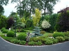 Beautiful combination of evergreens and shrubs. Not too much color or variety. Very well designed.