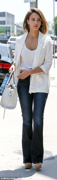 Fashion flare: Wearing a pair of high waisted jeans teamed with cork platforms she channel...