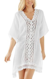 It's easy to add oomph to your beach outfit, especially when you have a bikini cover-up as pretty as this white lace-panel kaftan dress.