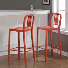 These stylish stools showcase a durable, all-steel construction and a vibrant tangerine color. This set of two bar stools also features a contoured seat, scratch-resistant powder coat finish and non-mar foot glides.