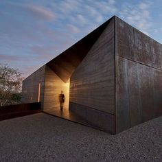 this house in arizona features a beautiful wedge entry where light pours out into the exterior desert homesexterior designminimalismmodern - Desert Home Exterior Designs