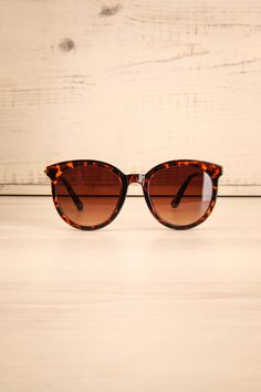 Lorica Tortoise #boutique1861 / Stylish and practical, these sunglasses will become your go-to pair this summer! The smokey lenses, the coloured plastic frame, and the metallic arms go hand-in-hand to make these attention-grabbing accessories.