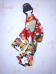 Japanese paper doll (height: 15 cm) hand-made from cardstock and yuzen washi. Background: Scrapbook paper (A4 size) of bamboo motif.