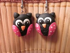 """Another great pair of earrings; they're larger than they look in the photo (the owls are close to 1"""" tall)    Handmade polymer clay black and pink polymer clay owl earrings"""