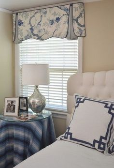 Simple White Faux Wood Blinds and Top Valance treatment