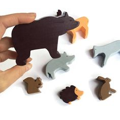 Wooden toys of forest animals - Waldorf figurines - gift for kids boys and girls 7 figurines including a deer, a bear, a boar, a wolf, a hare, a squirrel and a hedgehog Your child will have hours of fun playing with the figurines. The pieces are made of solid pine wood. The forest animals have been hand cut, painted with toy safe paints and varnished with an organic varnish (also certified toy safe). All the pieces have been sanded and the edges rounded to make it soft for childrens little…