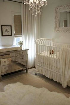 Glamorous #nursery for a girl, complete with mirrored dresser and chandelier.