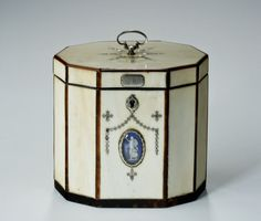Antique ivory tea caddy. A late 18th century tented tea caddy with veneered ivory panels and applied silver mounts. the front with an oval blue and gilt medalion. English circa 1780