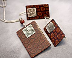 Silver and polymer caned layered pendant and earring set  $110.00 Materials: polymer clay, pmc, fine silver, silver, sterling chain, tiger eye