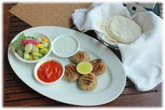 Turkish Fish Cakes with accompanying dips & warm pita breads..  Review of Restaurants: Fava, Bangalore