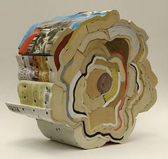 Reuse of Books = Art   --   Jonathan Callen uses large screws to hold the books together. joseebienvenugallery.com