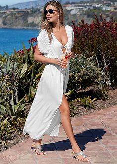 Take a walk on the beach in the Venus warm breeze maxi cover-up with Venus rhinestone flat.