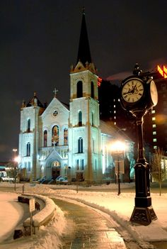 Sacred Heart Catholic Church on a snowy evening in the heart of downtown Peoria, IL