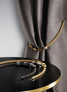 SAHCO / Accessories by Ulf Moritz - TITANIA P078 is a tie-back made of subtle, metallic pearls with high-gloss details.