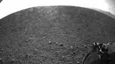 """One of the First Images  This is one of the first images taken by NASA's Curiosity rover, which landed on Mars early Monday. It was taken with a fisheye wide-angle lens on the left """"eye"""" of a stereo pair of Hazard-Avoidance cameras on the left-rear side of the rover."""