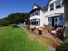 Enjoy the sun and the views from the Hotel decking - Loch Melfort Hotel