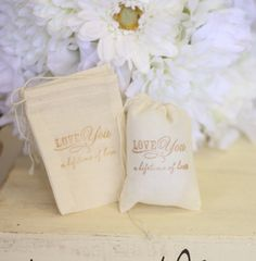 "Favors:  Stamped with ""Love you a lifetime of love.""  Fill with what was the loved one's favorite candy, soap, herbs..."