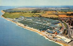 An aerial shot of Butlin's Clacton Holdiay Camp from The densely packing of the chalets would ensure that few guests would experience sunshine, other than on the beach. The military origins of many of the buildings is clear. Butlins Holidays, British Holidays, Bognor Regis, Seaside Holidays, Park Playground, 7 Continents, Interesting Buildings, Places Of Interest, World Best Photos