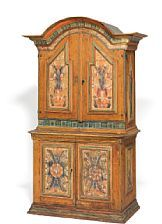 A Swedish pinewood country cupboard from Dalarna, decorated with flowers and patterns, arched profiled top, front with four doors enclosing shelves. 18th century. H. 225 cm. W. 116 cm. D. 68 cm.