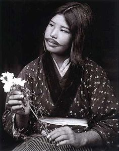 Ainu woman with traditional lip tattoo.