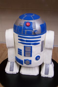 "R2D2 - Finally got one of these bad boys under my belt!  Now I am ready to do one again even better...funny how much you learn from the first one....I would like to get a little more detailed and be a little more prepared.  Customer LOVED it and that's all that matters to me!  Well.....almost.....I always see room for improvement...hehehe!  Thanks for looking! ;)  Oh, this was 3 -6"" rounds stacked with 1/2 of the wilton ball pan on top... covered in fondant...legs rice crispy treats."