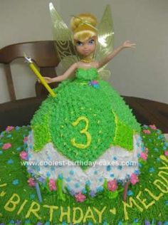 My almost 3 yr old REALLY wanted a Tinkerbell Cake for her birthday and I thought the head only Wilton one was kind of boring. So, I actually looked at
