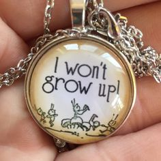 won't grow up! CLOSET CLEAR OUTITEM IS REDUCED 50% Silver tone about 20 inches. Medallion is glass and alloy. It's about an inch. Jewelry Necklaces
