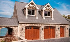 @Clopay Doors | Residential Garage Doors and Entry Doors | Commercial Doors Canyon Ridge Faux Wood Carriage House Style Garage Doors Series 1 Design 13 with Arch 3 Glass & Decorative Hardware