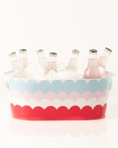 Instead of using a cumbersome (and unsightly) cooler, set out a beverage bucket with an assortment of cold drinks to keep party guests refreshed. Liven up the plain exterior with a fun design or pattern created with Martha Stewart Multi-Surface Acrylic Craft Paint.