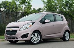 2013 Chevrolet Spark - pink - front three-quarter view