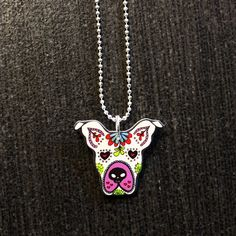 """On sale! Normally $14.99    These adorable sugar skull pit bull charms are approx 1/2"""" in size. They are made from hard cut plastic, a durable and surprisingly lightweight material. The charms are sealed with a clear sealant. Each charm comes on a 17"""" silver plated ball chain."""