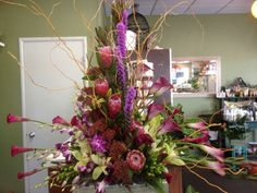 Tropical protea, orchids and callas