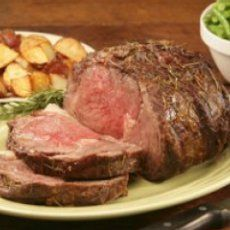Rib Roast with Roasted-Garlic Thyme Sauce        7-8 lbs beef (trimmed prime, rib roast sometimes called standing rib roast; 3 or 4 ribs)  1  T vegetable oil  2 heads garlic  3 T chopped fresh thyme (leaves)  14 c  shallot (minced)  2 T wine vinegar  1 1/2 c  dry red wine  1 bay leaf  3 c  veal (or beef demiglace or 4 cups beef broth)  1 1/2 T unsalted butter (softened)  1 1/2 T all-purpose flour…